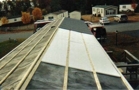 Mobile Home Roof Overs | A Quick Guide To This Great Home ... on shingle over existing roof, small home roof, villa roof, attached roof, slingshot roof, rubber roof, franklin roof, modular roof, florida home roof, bamboo roof, kayak foam roof, trailer roof, town home roof, homes with 6 12 pitch roof, jacks for shingling roof, trim roof, low rise roof, motor home roof, tri level roof,