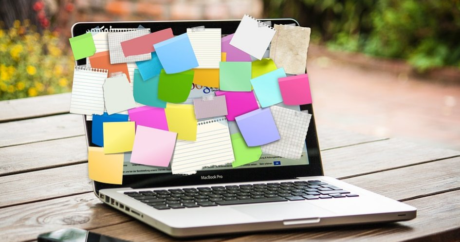 Planning with sticky notes on laptop screen
