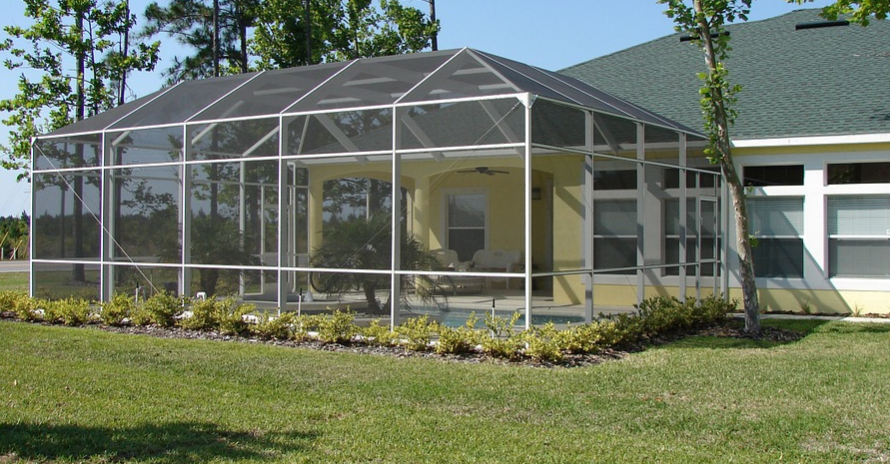 Sunroom added to the side of a yellow home