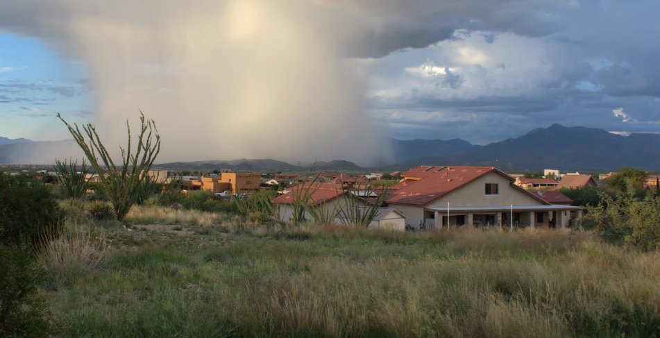 Storm approaching from afar to houses