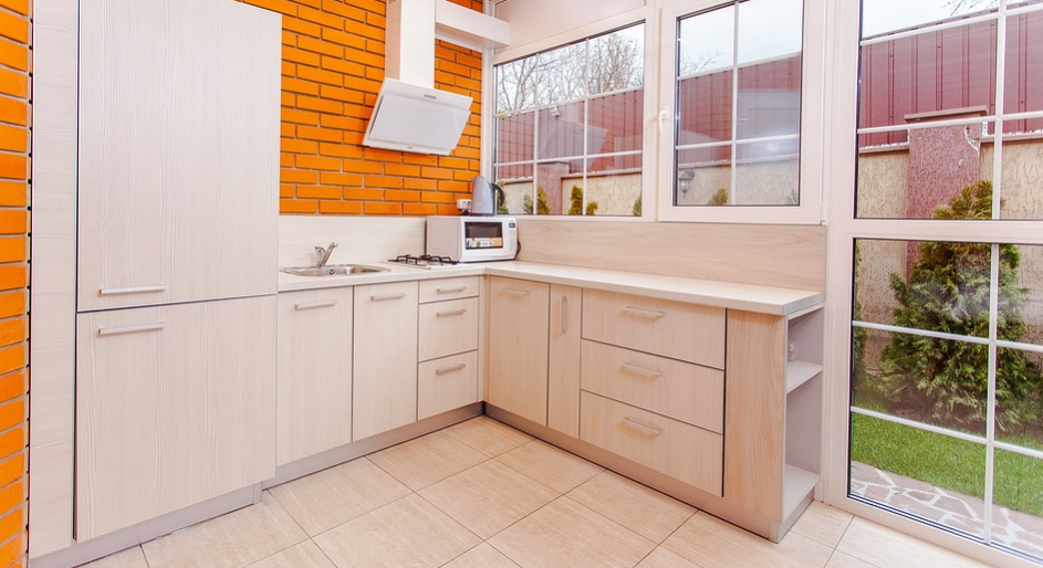 A remodeled kitchen with orange brick walls