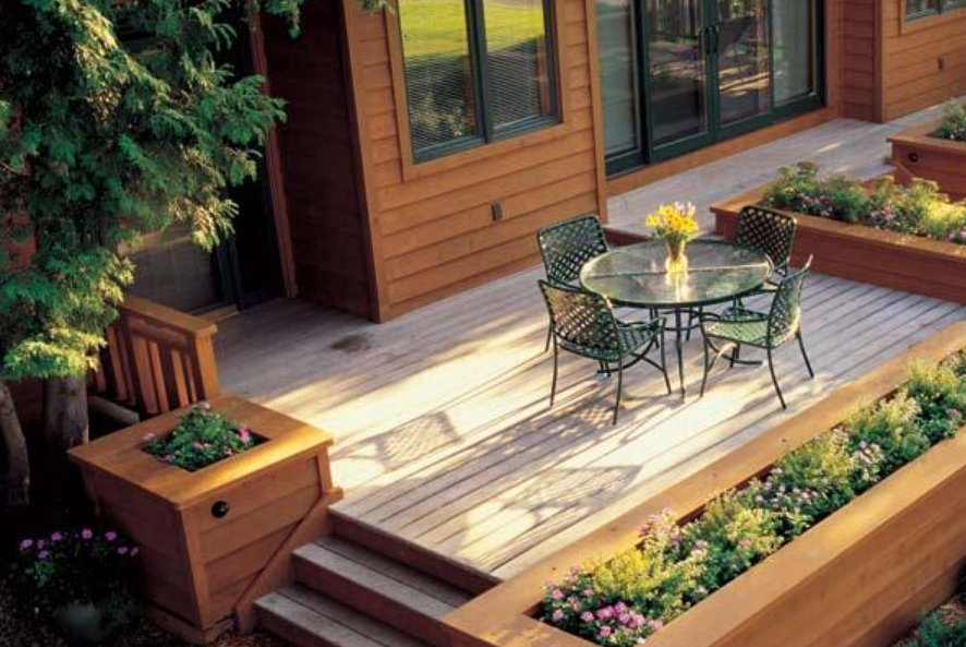 A mobile home deck with planters