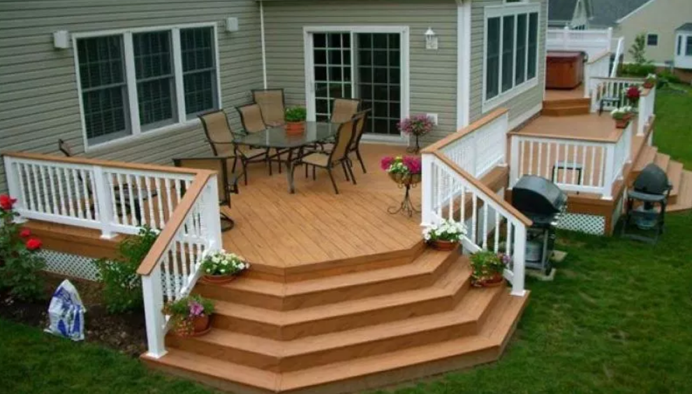 A mobile home deck with wide stairs
