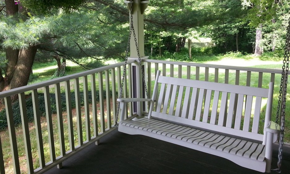 A white porch swing