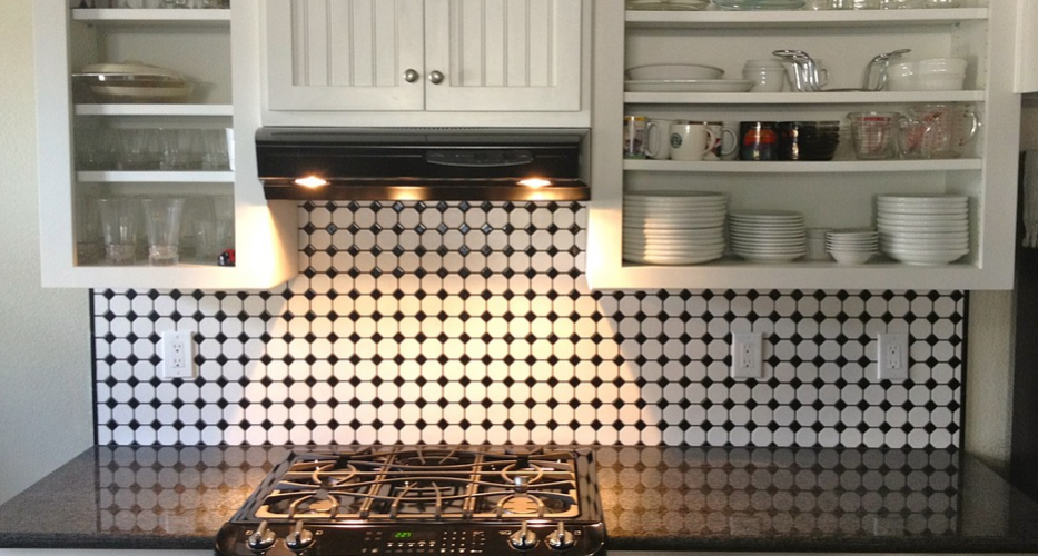 Black and white tiled kitchen wall