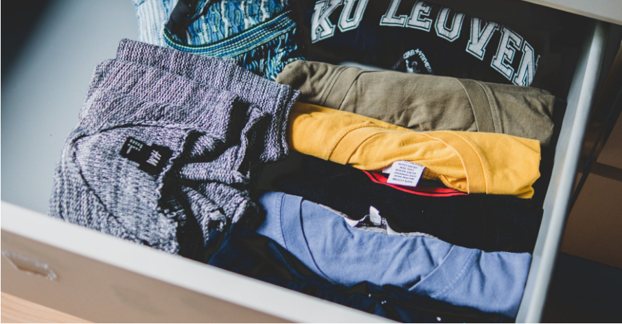 Clothes rolled up neatly in a drawer
