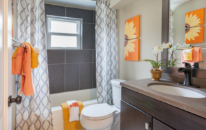 Small bathroom with orange decor