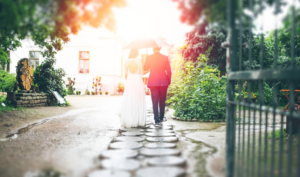 Married couple walking towards a house