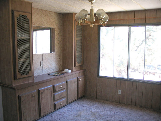 inside mobile home with paneling - before photo