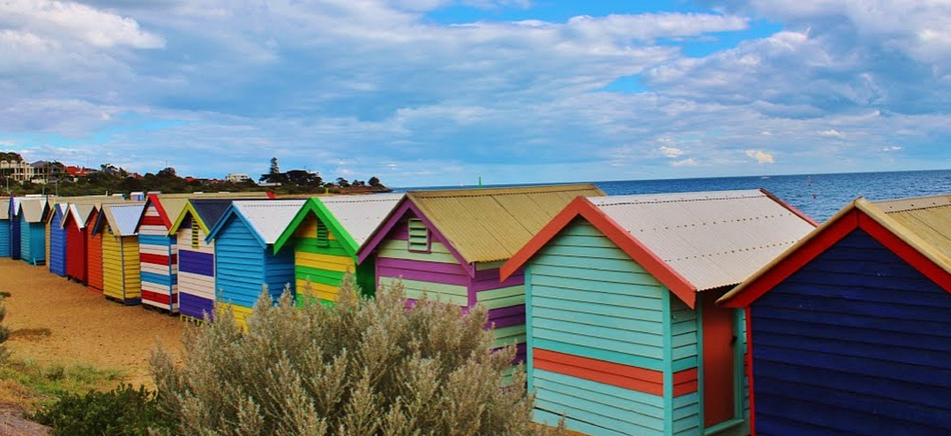 Colorful beach shack houses on the coast