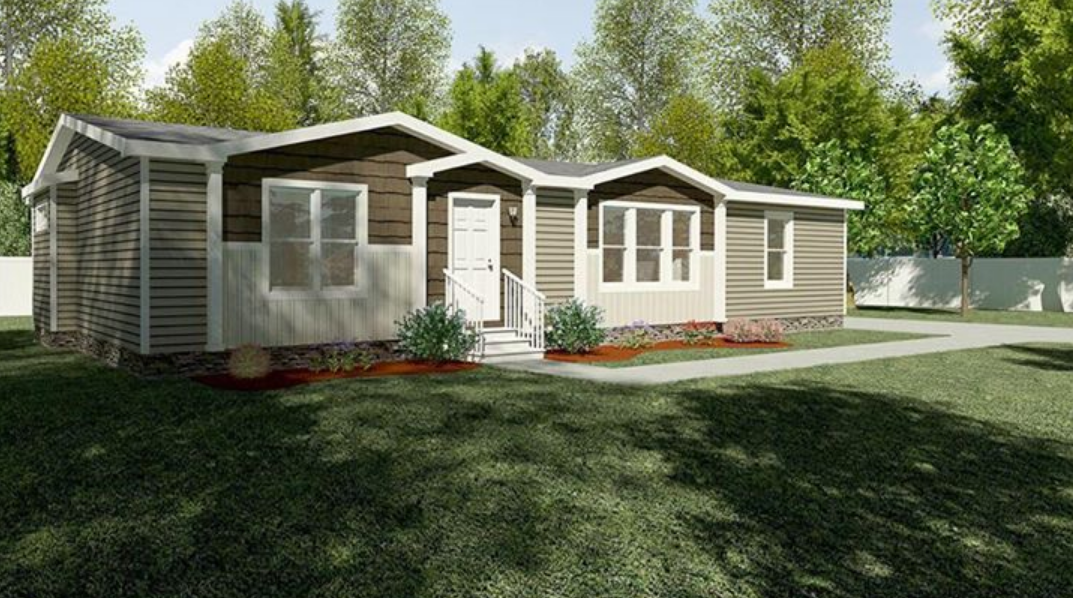 Exterior of a mobile home with a lawn
