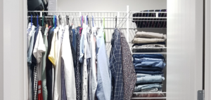 Closet space with clothes hung and folded