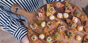 An array of canapes on a wooden board