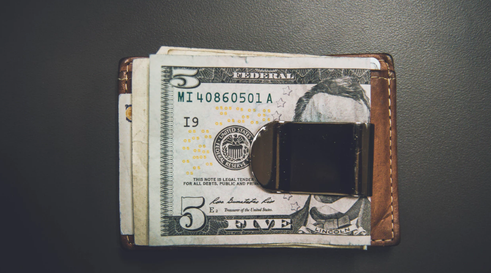 Cash in a money clip wallet