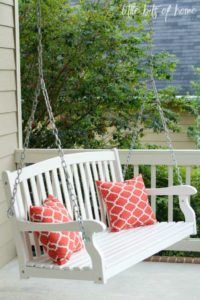 Swing on porch with pillows