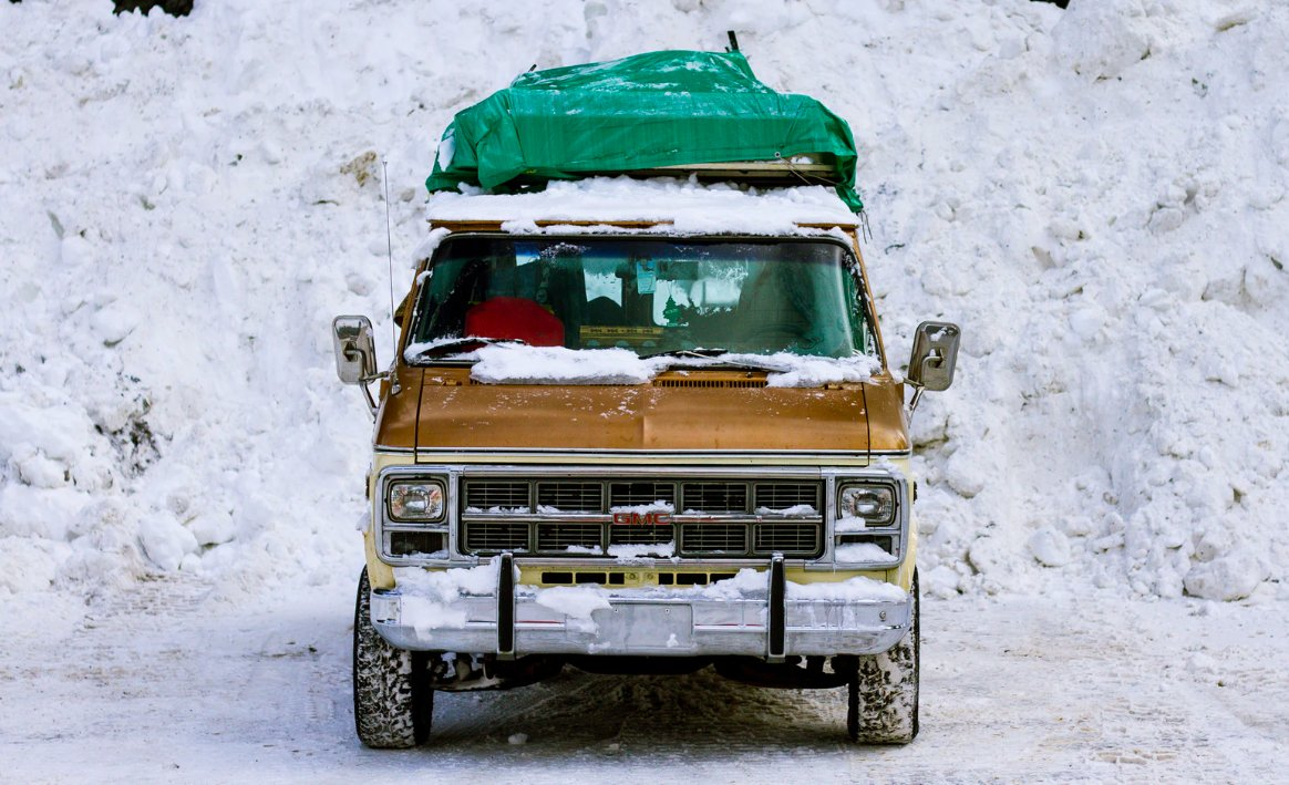 Truck parked with snow