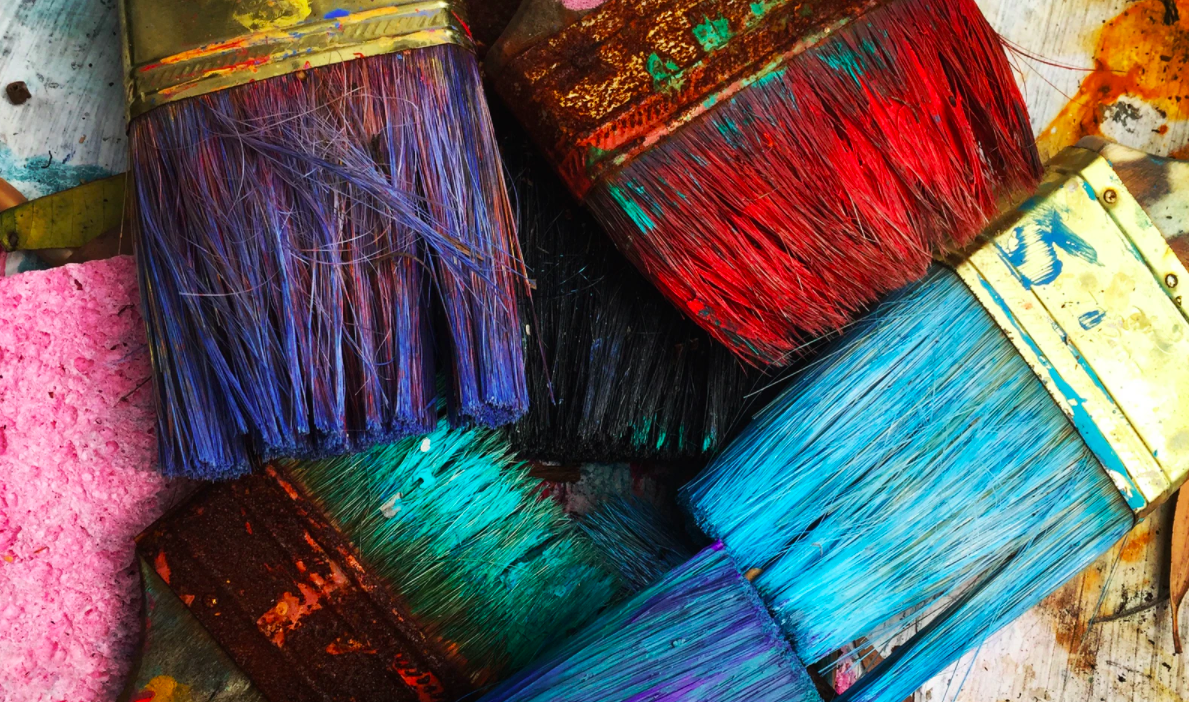 Various colored used paintbrushes